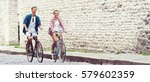 young couple of hipsters riding ... | Shutterstock . vector #579602359