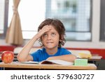 happy boy thinking at school. | Shutterstock . vector #579630727