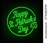 glowing neon sign   happy st.... | Shutterstock .eps vector #579680599