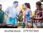 friends having a barbecue party ... | Shutterstock . vector #579707365