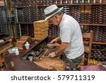 folding cigars in tobacco store.... | Shutterstock . vector #579711319