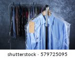 rack of clean clothes hanging... | Shutterstock . vector #579725095