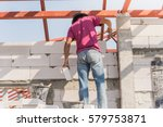 industrial bricklayer... | Shutterstock . vector #579753871