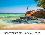 the happy young man jumping off ...   Shutterstock . vector #579761905