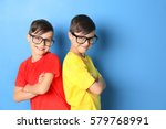 Twin Brothers In Glasses On...