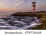 waves crashing into lighthouse... | Shutterstock . vector #579774169
