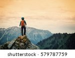 successful woman backpacker... | Shutterstock . vector #579787759