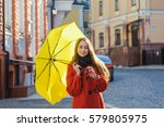 young woman with a yellow... | Shutterstock . vector #579805975
