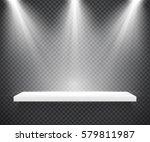 empty white shelf illuminated... | Shutterstock .eps vector #579811987