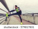 urban jogger stretching  ... | Shutterstock . vector #579817831