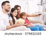 happy family watching tv on