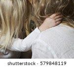 family. hands of little girl... | Shutterstock . vector #579848119