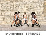 Beautiful modern dancers in the ancient  Kourion amphitheatre in Cyprus. - stock photo