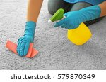 woman cleaning carpet with... | Shutterstock . vector #579870349
