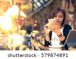 asian woman in coffee shop cafe | Shutterstock . vector #579874891