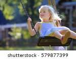 little girl playing at... | Shutterstock . vector #579877399