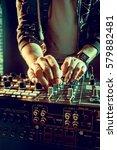 dj playing music at mixer... | Shutterstock . vector #579882481