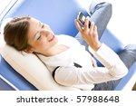 woman with mobile phone lying... | Shutterstock . vector #57988648