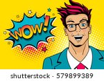Wow pop art male face. Young sexy surprised man in glasses with open mouth and Wow speech bubble with stars. Vector colorful illustration in retro comic style. Party invitation poster. | Shutterstock vector #579899389