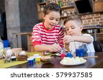 cute little kids painting... | Shutterstock . vector #579937585