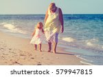 happy grandmother with little... | Shutterstock . vector #579947815