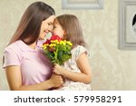 woman and child with bouquet of ... | Shutterstock . vector #579958291