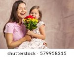 woman and child with bouquet of ... | Shutterstock . vector #579958315