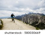 view of cyclist riding mountain ... | Shutterstock . vector #580030669