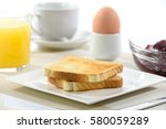 crispy toast on a plate and a... | Shutterstock . vector #580059289