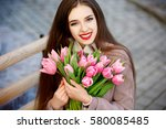 beautiful young woman with... | Shutterstock . vector #580085485