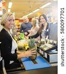 confident cashier holding... | Shutterstock . vector #580097701