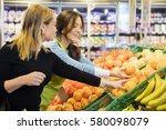 customer and saleswoman... | Shutterstock . vector #580098079