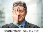 closeup of smiling embarrassed... | Shutterstock . vector #580112719