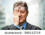 closeup of smiling embarrassed... | Shutterstock . vector #580112719