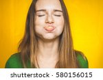 funny eats woman with full... | Shutterstock . vector #580156015