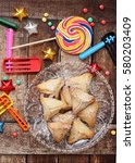 Small photo of Ozney Haman cookies with noisemaker and other Purim holiday items