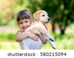 Stock photo little girl with a golden retriever puppy a puppy in the hands of a girl 580215094