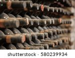 old wine bottles covered with... | Shutterstock . vector #580239934