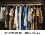 women clothes on racks in a... | Shutterstock . vector #580240189