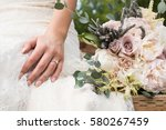 wedding ring and bouquet | Shutterstock . vector #580267459