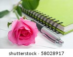 rose pen and notebook on white - stock photo