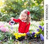 Child Planting Spring Flowers...