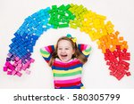 funny little girl playing with... | Shutterstock . vector #580305799