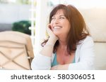 attractive middle aged woman... | Shutterstock . vector #580306051