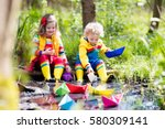 children play with colorful... | Shutterstock . vector #580309141