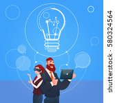 business man and woman wear... | Shutterstock .eps vector #580324564