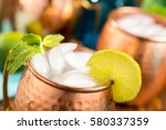 moscow mule with lime and mint. ... | Shutterstock . vector #580337359