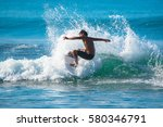 riding the waves. costa rica ... | Shutterstock . vector #580346791