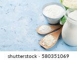 dairy products on stone table.... | Shutterstock . vector #580351069