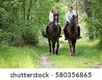young couple riding horses. | Shutterstock . vector #580356865